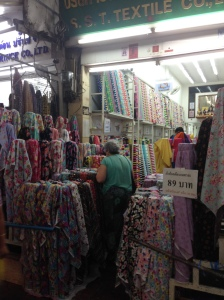 #159 Sampeng Lane, S.S.T.Textile Co.,Ltd. They have cotton fabric at 89 baht per meter. Their novelty fabric is really cute, with postage stamps, cupcakes, florals, stripes, polka dots, musical notes, and pretty border fabrics.